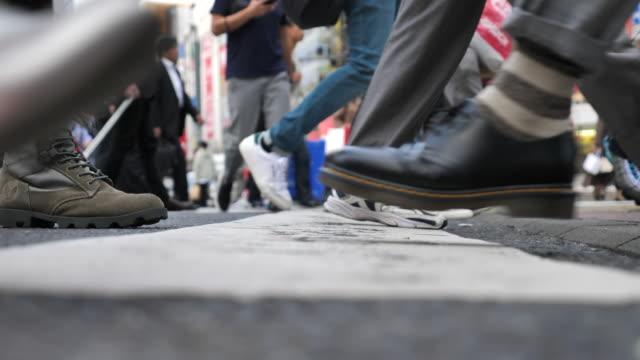 Close-up of Leg People walking on the crosswalk
