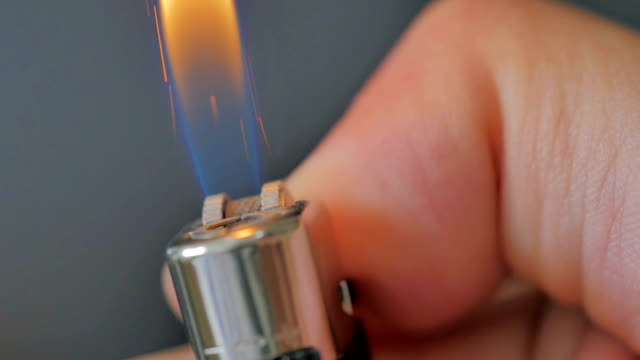 Close-up of lighter igniting on black background,Slow Motion video