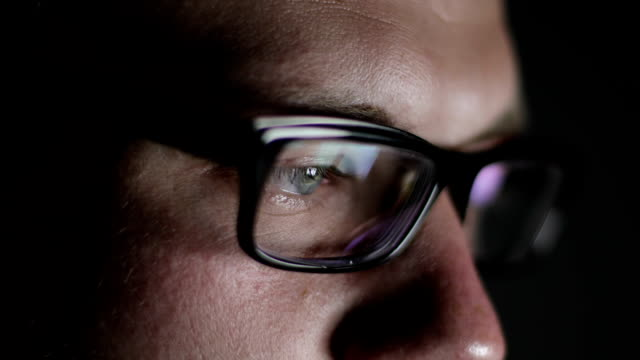 close-up of male eyes with glasses. - businessman video stock e b–roll