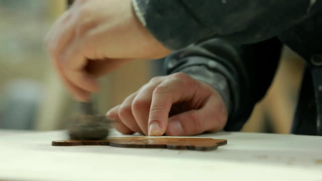 close-up of male hand of a professional wood stain products stain in the enterprise video