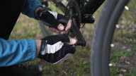 istock Close-up of male hands adjust the pedals on a bicycle. 1286659148