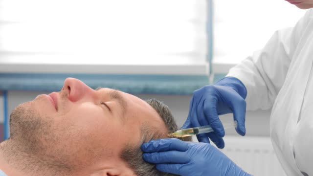 Close-up of male patient while PRP injections procedure video