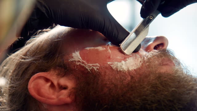 Close-up of man being groomed video