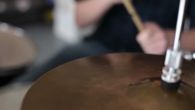 Closeup of man playing drums video