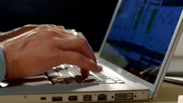 Close-up of man typing text on his computer video