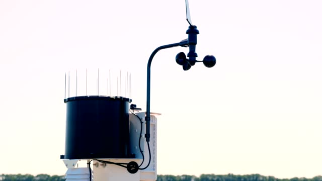 close-up of meteorological instrument. A small weather station on a farm field, near the irrigation tank. The concept of smart farming technology - vídeo