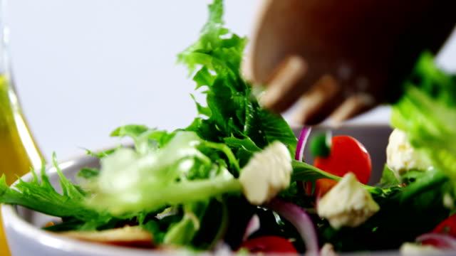 Close-up of mixing salad