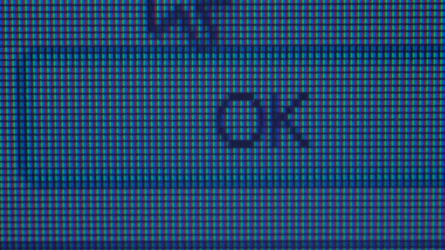 Closeup of mouse clicking on ok button