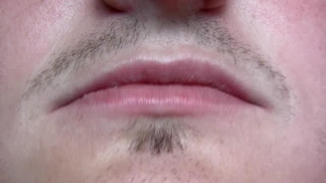 close-up of mouth talking - blåsa en kyss bildbanksvideor och videomaterial från bakom kulisserna