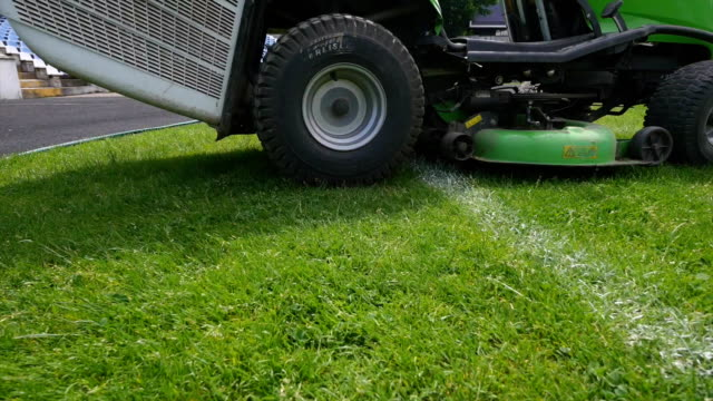 Closeup of mower cutting the grass video