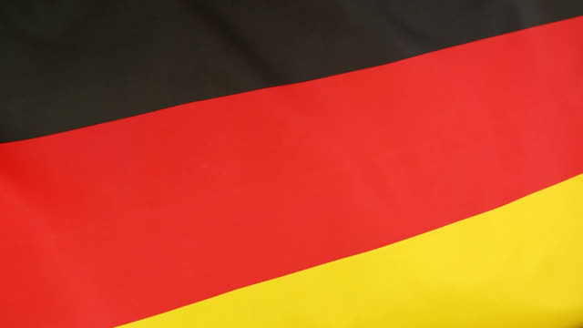 Closeup of national flag of Germany in slow motion video