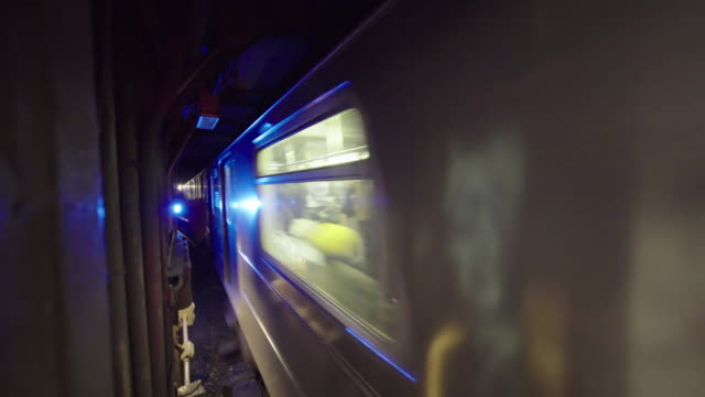 Close-up of New York subway train passing deep inside tunnel.