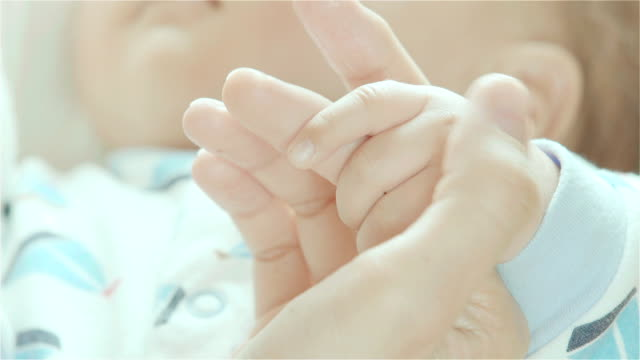 Close-up of Newborn baby holding mother's finger video