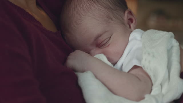 Close-Up of Newborn Infant Being Held by Mother video