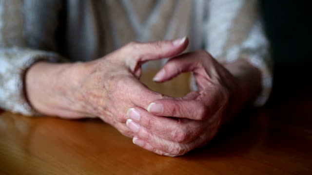 closeup of old woman's hands on table moving nervously closeup of old woman's hands on table moving nervously impatient stock videos & royalty-free footage
