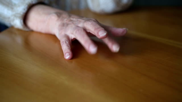 closeup of old woman's hands tapping nervous on table closeup of old woman's hands tapping nervous on table impatient stock videos & royalty-free footage