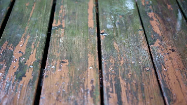 closeup of old wooden planks in the rain video