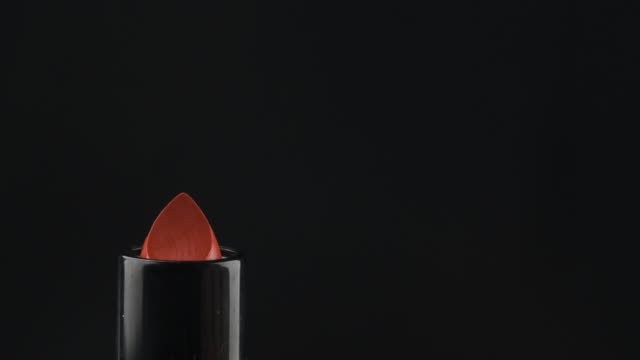 Close-up of opening lipstick. Opening red lipstick isolated on black. Close-up of opening lipstick. Opening red lipstick isolated on black. Copy space lip balm stock videos & royalty-free footage