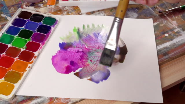 Closeup of paintbrush on the picture video