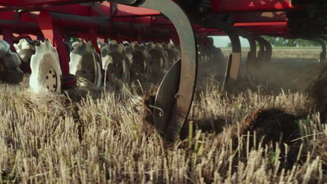 A close-up of part of the agricultural mechanism for integrated land cultivation. Crop shot A close-up of part of the agricultural mechanism for integrated land cultivation plow stock videos & royalty-free footage