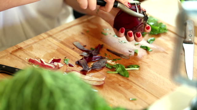 Close-up of peeling beetroot with peeler video