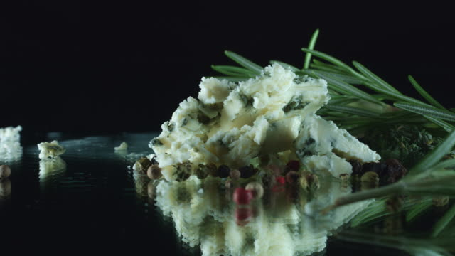 4K Close-up of Pieces of Blue Cheese with Herbs video