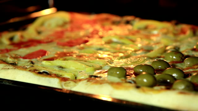 Closeup of pizza cooking video