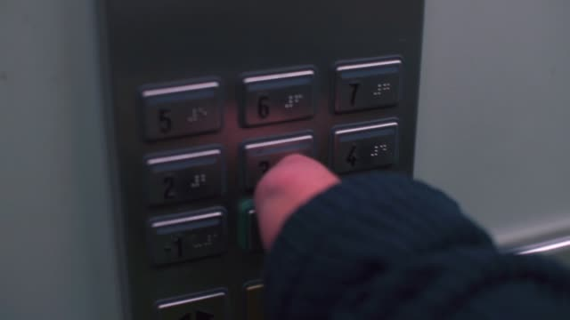 Closeup of pushing elevator button of a stump of a hand.
