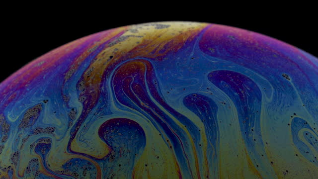 Close-up of rainbow colored soap bubble