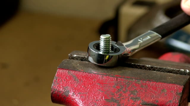 closeup of ratchet wrench tightening nut video