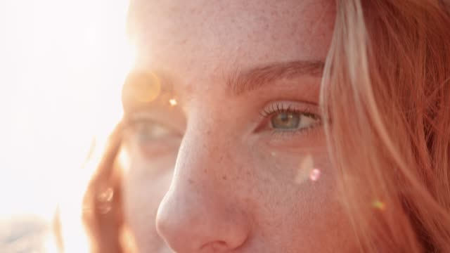 Close-up of redhead woman with green eyes and freckles video