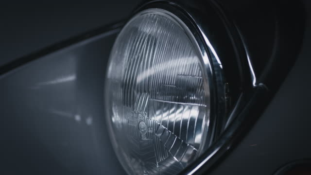 Close-up of reflection on vintage car headlight