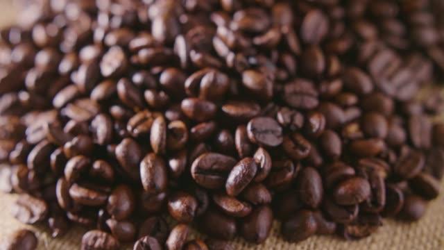 Closeup Of Roasted Coffee Beans On Hessian Sack 4K video