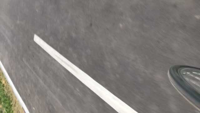 Closeup of rolling wheel on bike lane