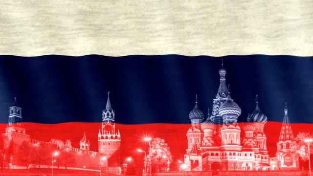 närbild av rysk flagga blåst i vinden. spasskaya stad och st basils katedralen röda torget siluett längst ned. symbol för ryssland. - vasilijkatedralen bildbanksvideor och videomaterial från bakom kulisserna