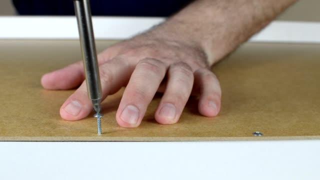 close-up of screwing a bolt - затягивание стоковые видео и кадры b-roll