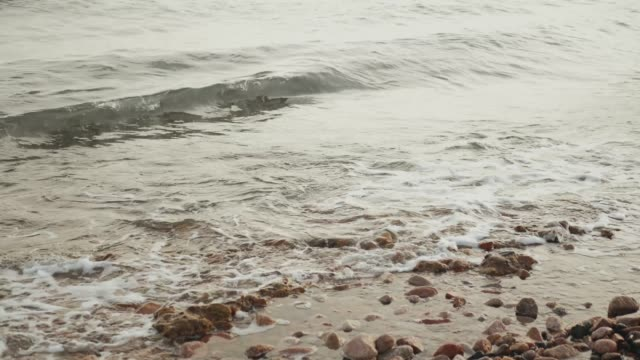 Close-up of Sea waves, Egypt red sea, stone beach, slow motion, 4k