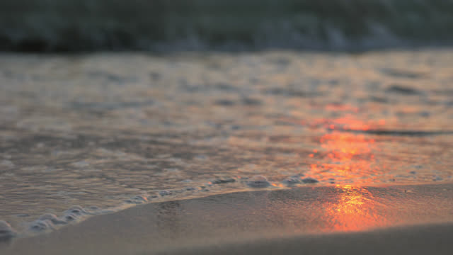 Closeup Of Sea Waves On Sandy Beach At Sunset video