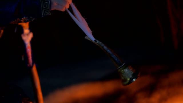 Close-up of shaman ritual bell swinging.