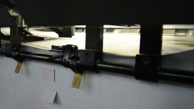 closeup of sheet delivery on offset machine into print-shop. - lithograph stock videos & royalty-free footage
