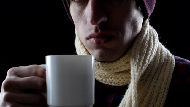 Close-up of sick man drinking hot tea close up of Sick young man coughing emphysema stock videos & royalty-free footage
