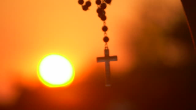 Closeup Of Silhouette Cross Hanging at sunset