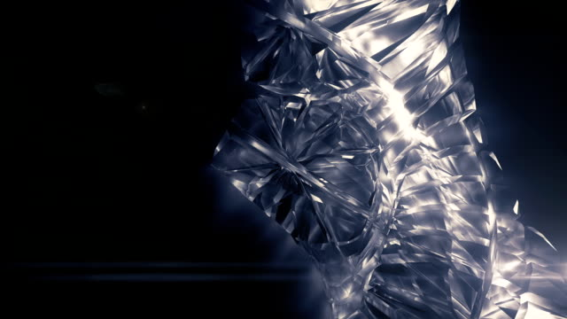 Close-up of slow rotate shiny glass three-dimensional shape. Beautiful background. 3d rendering. HD resolution
