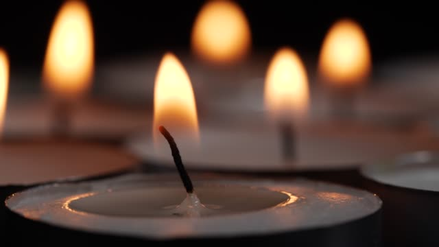 Close-up of small burning candles video