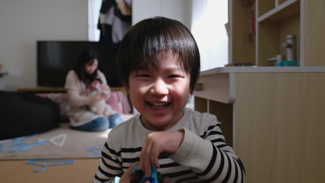 Closeup of smiling child Smiling child looking at camera childhood stock videos & royalty-free footage