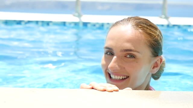 Close-up of smiling woman in pool video