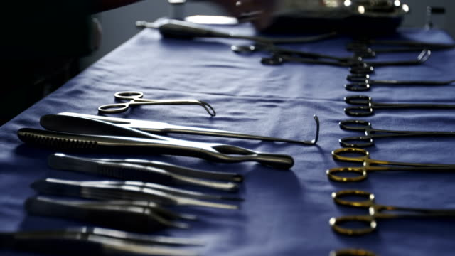 Close-up of surgeon arranging surgical tools on tray video