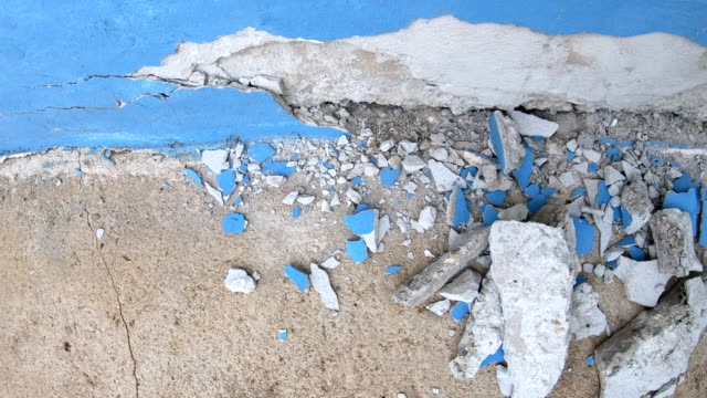 Close-up of the broken concrete corner of the room.