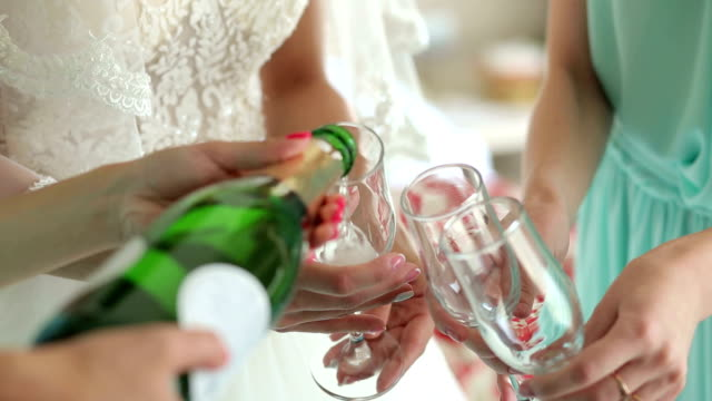 close-up of the girl poured champagne into glasses at a bachelorette party. - bachelorette party stock videos and b-roll footage