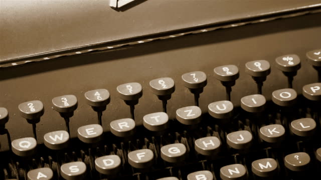 closeup of the keys of an old typewriter. - steampunk fashion stock videos and b-roll footage